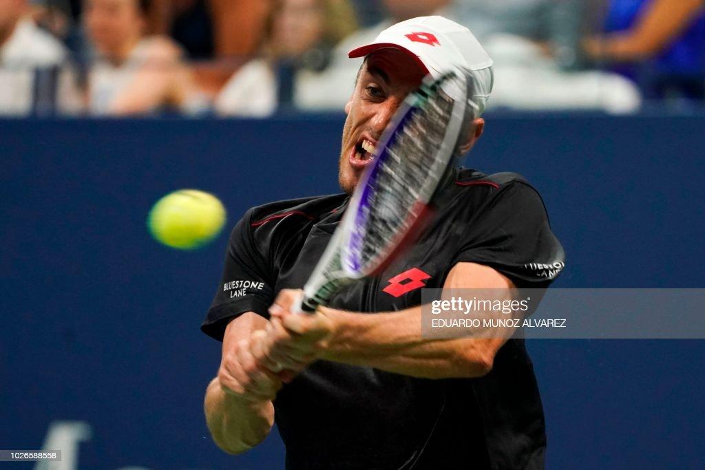 TOPSHOT - Australia's John Millman returns the ball to Switzerland's Roger Federer during their 2018 US Open Men's Singles tennis match at the USTA Billie Jean King National Tennis Center in New York on September 3, 2018.