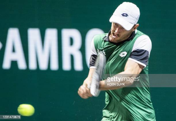Australia's John Millman returns to compatriot Alex de Minaur on the second day of the Rotterdam ATP tennis tournament, on March 2, 2021. /...