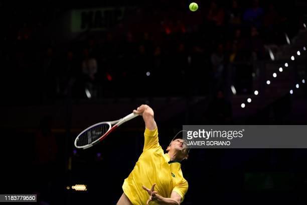 Australia's John Millman serves to Canada's Vasek Pospisil during a quarter-final singles tennis match Australia against Canada at the Davis Cup...