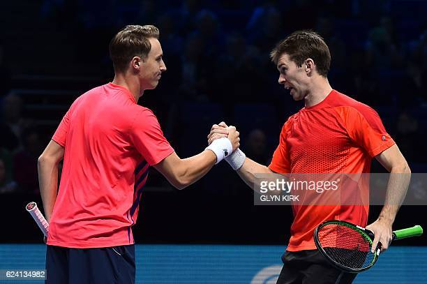 Australia's John Peers and Finland's Henri Kontinen celebrate after beating France's PierreHugues Herbert and France's Nicolas Mahut in their round...