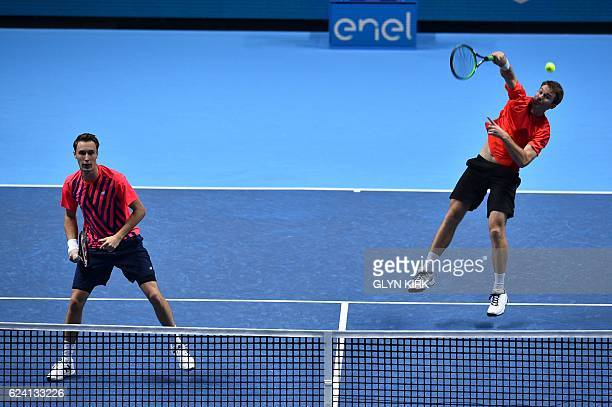 Australia's John Peers and Finland's Henri Kontinen return to France's PierreHugues Herbert and France's Nicolas Mahut during their round robin stage...
