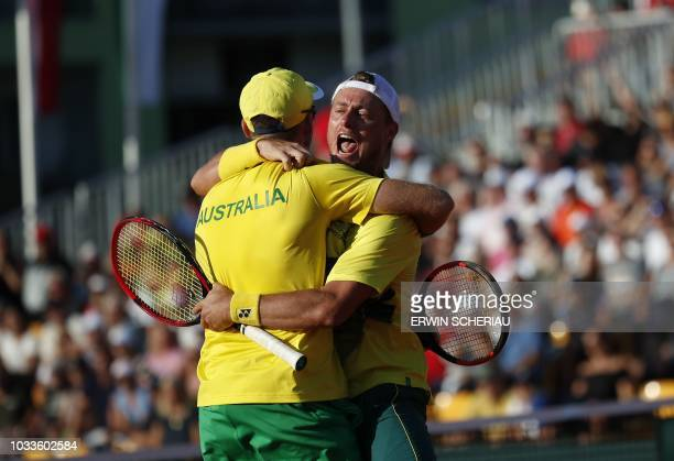 Australia's John Peers celebrates with his teammate Lleyton Hewitt during their tennis double match against Austria's Oliver Marach/Juergen Melzer...