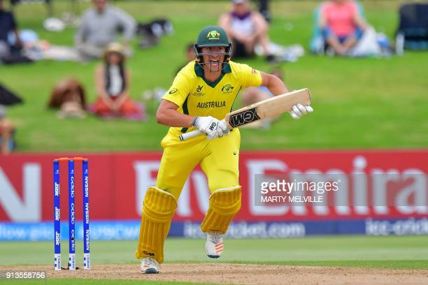 Australia's Jonathan Merlo makes a run during the U19 World Cup cricket final match between India and Australia at Bay Oval in Mount Maunganui on...
