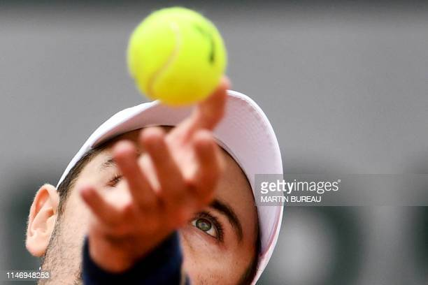 Australia's Jordan Thompson serves the ball to Croatia's Ivo Karlovic during their men's singles second round match on day five of The Roland Garros...