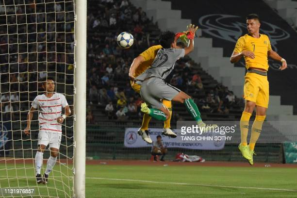 Australia's Joseph Champness heads a goal against Cambodia's goalkeeper Hul Kimhuy during the Tokyo 2020 Olympic Games men's Asian qualifier football...