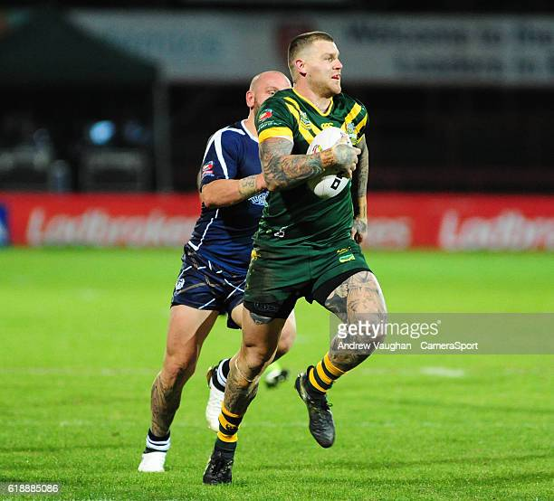 Australia's Josh Dugan drives forward to score his sides seventh try during the Four Nations match between the Australian Kangaroos and Scotland at...