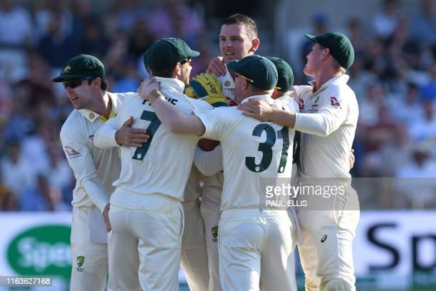 Australia's Josh Hazlewood celebrates with teammates after taking the wicket of England's Joe Denly for 50 on the third day of the third Ashes...