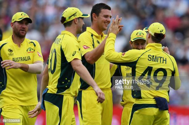 Australia's Josh Hazlewood celebrateswith teammates after taking his sixth wicket during the ICC Champions trophy cricket match between Australia and...