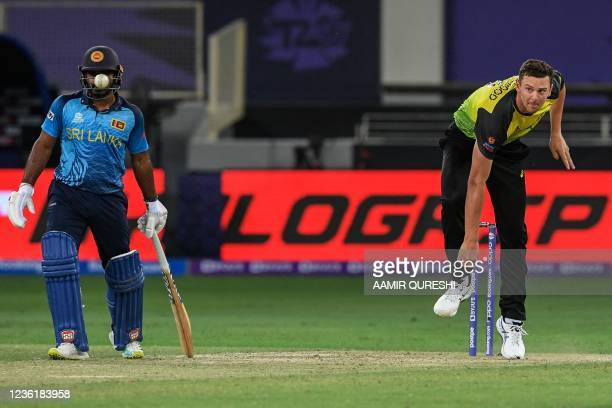 Australia's Josh Hazlewood delivers a ball during the ICC mens Twenty20 World Cup cricket match between Australia and Sri Lanka at the Dubai...