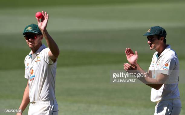 Australia's Josh Hazlewood is applauded by fellow paceman Pat Cummins after taking five Indian wickets as India is dismissed for only 36 runs on the...