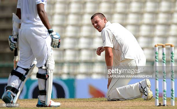 Australia's Josh Hazlewood rises after delivering a ball during the third day of the opening Test match between Sri Lanka and Australia at the...