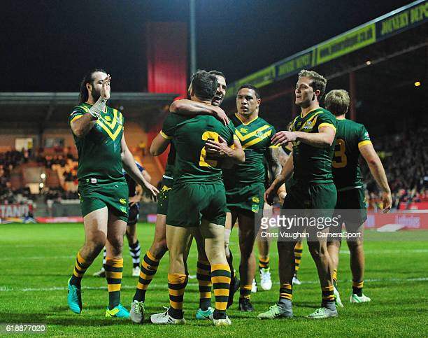 Australia's Josh Mansour celebrates scoring his sides fifth try with teammates during the Four Nations match between the Australian Kangaroos and...