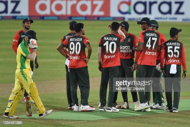 Australia's Josh Philippe walks back to the pavilion after his dismissal during first Twenty20 international cricket match between Bangladesh and...