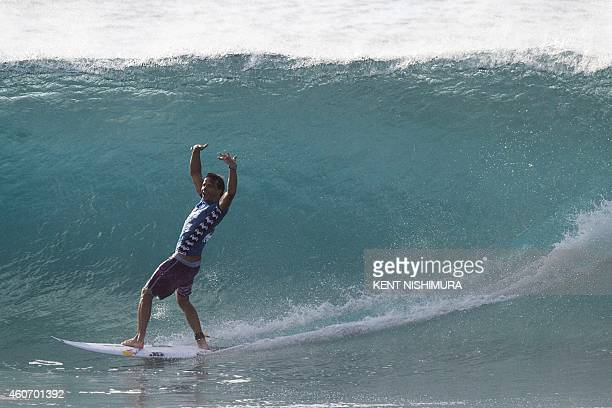 Australia's Julian Wilson celebrates after emerging from a barrel in the finals against Brazil's Gabriel Medina on the final day of the Billabong...