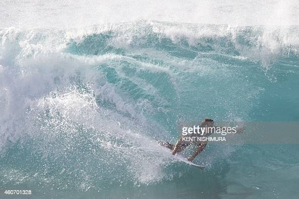 Australia's Julian Wilson surfs in the finals of the Billabong Pipeline Masters event of the Vans Triple Crown of Surfing at Ehukai Beach Park on...