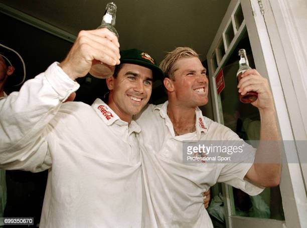 Australia's Justin Langer and Shane Warne celebrate winning the 5th Test match between England and Australia by 264 runs giving them an unassailable...