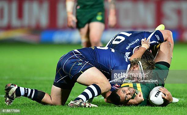Australia's Justin O'Neill is tackled byScotland's Sheldon PoweHobbs left and Scotland's Luke Douglas during the Four Nations match between the...
