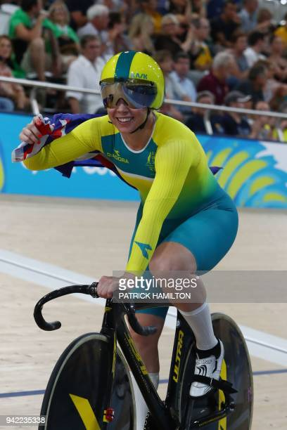Australia's Kaarle Mcculloch celebrates her gold medal win after competing in the women's team sprint finals track cycling event during the 2018 Gold...