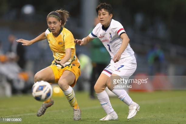 Australias Karly Roestbakken and Taiwan's Chen Yenping challenge for the ball during the women's Olympic football tournament qualifier match between...