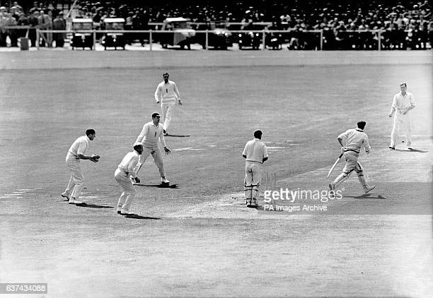 Australia's Keith Miller is bowled by England's Jim Laker for a duck