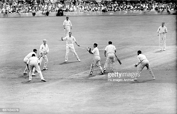 Australia's Ken MacKay is caught by England's Alan Oakman off the bowling of Jim Laker for a duck