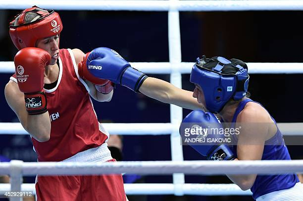 Australia's Kristy Harris fights Canada's Mandy Bujold during a Womens Fly QuarterFinal boxing match at the 2014 Commonwealth Games in Glasgow...