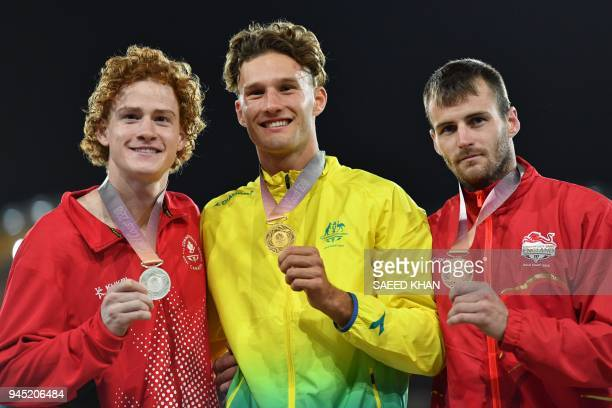 Australias Kurtis Marschall Canadas Shawnacy Barber and Englands Luke Cutts pose with their medals after the athletics men's pole vault final during...