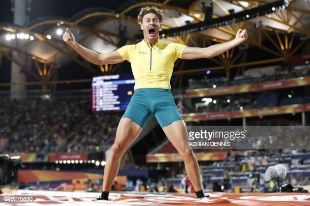 TOPSHOT Australias Kurtis Marschall celebrates in the athletics men's pole vault final during the 2018 Gold Coast Commonwealth Games at the Carrara...