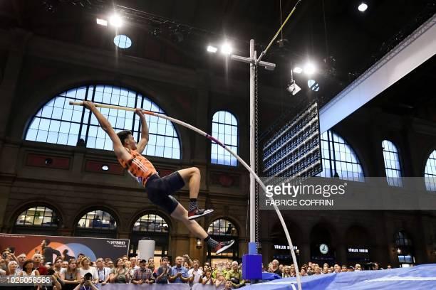 Australia's Kurtis Marschall competes in the men's pole vault event inside Zurich's main railway station during the IAAF Diamond League Athletics...