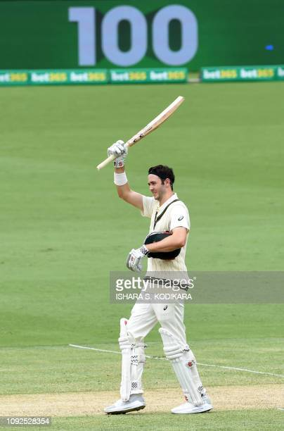 Australia's Kurtis Patterson celebrates after scoring a century during day two of the second Test cricket match between Australia and Sri Lanka at...
