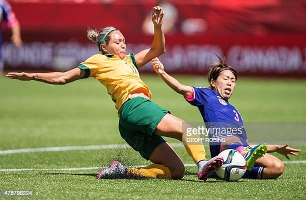Australia's Kyah Simon and Japan's Azusa Iwashimizu vie for the ball during their quarterfinal football match at the 2015 FIFA Women's World Cup at...