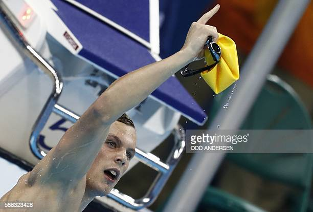 TOPSHOT Australia's Kyle Chalmers celebrates after he won the Men's 100m Freestyle Final during the swimming event at the Rio 2016 Olympic Games at...