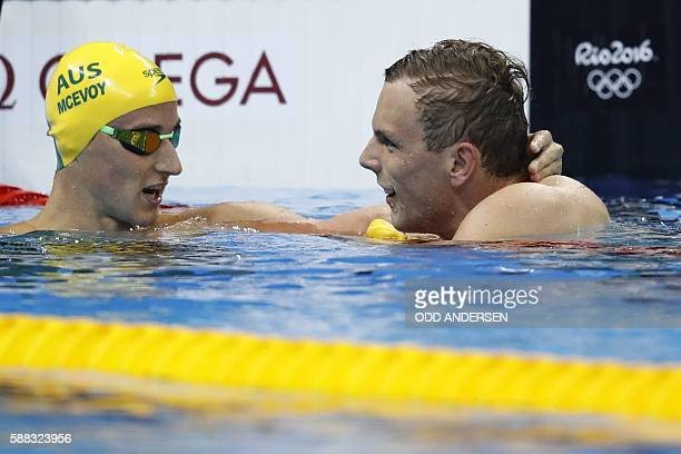 Australia's Kyle Chalmers celebrates with Australia's Cameron McEvoy after he won the Men's 100m Freestyle Final during the swimming event at the Rio...