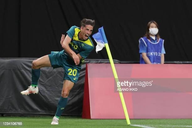 Australia's Lachlan Wales celebrates scoring during the Tokyo 2020 Olympic Games men's group C first round football match between Argentina and...