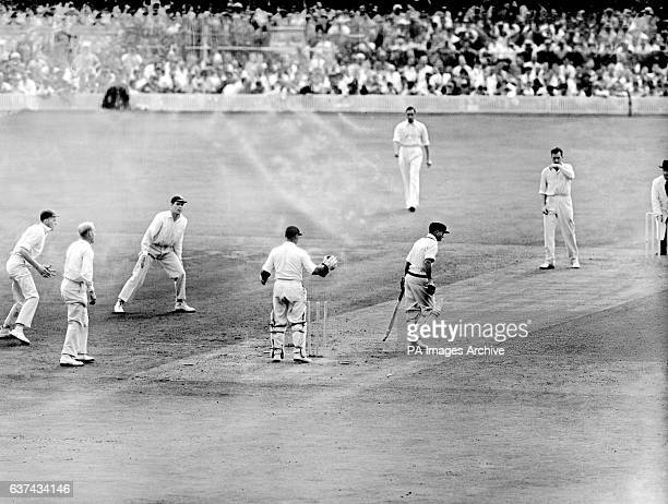 Australia's Laurie Maddocks walks after being bowled by England's Jim Laker for 4 runs