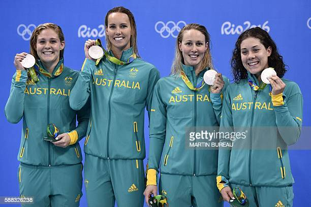 Australia's Leah Neale, Australia's Emma Mckeon, Australia's Bronte Barratt and Australia's Tamsin Cook pose with their silver medal on the podium of...