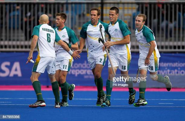 Australia's Liam De Young celebrates his goal with team mates against Great Britainduring the Visa International Invitational Hockey Tournament at...