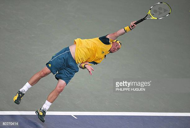 Australia's Lieyton Hewitt jumps to return the ball to Spain's Rafael Nadal during their men's singles second round tennis match for the 2008 Beijing...