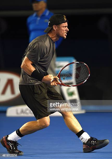 Australia's Lleyton Hewitt celebrates after victory in his men's singles match against Zhang Ze of China on day two of the 2015 Australian Open...