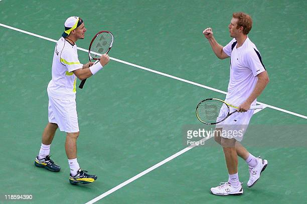 Australia's Lleyton Hewitt celebrates with teammate Chris Guccione after they defeated Gong Maoxin and Li Zhe of China during day two of the 2011...