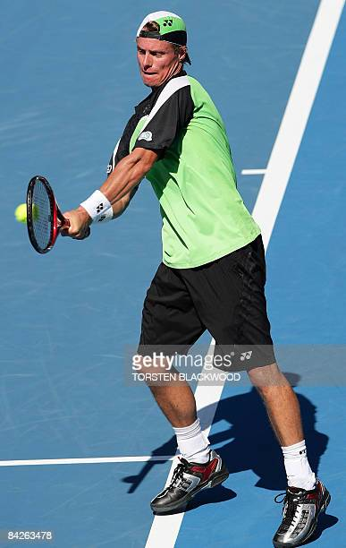 Australia's Lleyton Hewitt hits a return to Julien Benneteau of France during the second round of the Sydney International tennis tournament on...