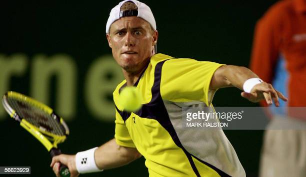 Australia's Lleyton Hewitt hits the ball during an Australian Open tennis tournament second round match against Argentina's Juan Ignacio Chela in...
