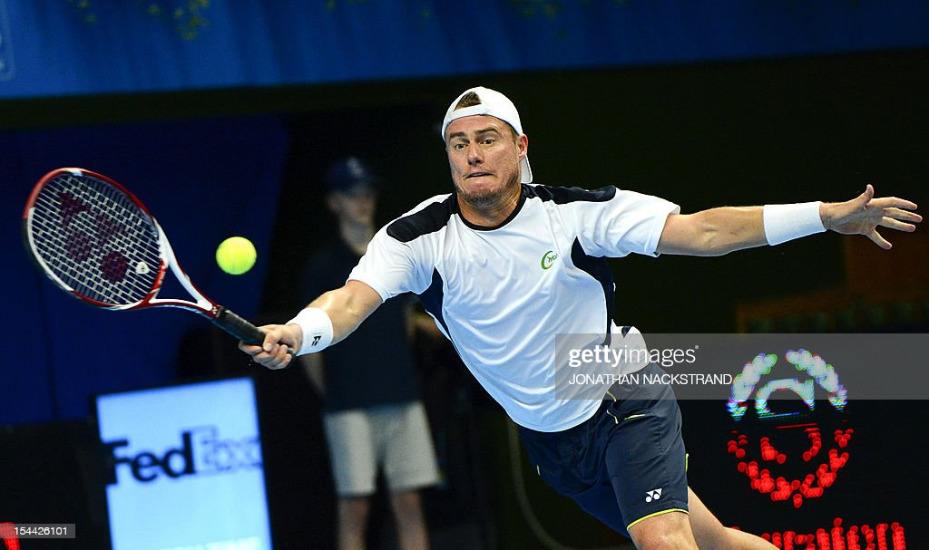 Australia's Lleyton Hewitt returns the ball to Spain's Nicolas Almagro during the quarter-finals at the ATP Stockholm Open tennis tournament on October 19, 2012 in Stockholm. Almagro won 6-1, 6-4.