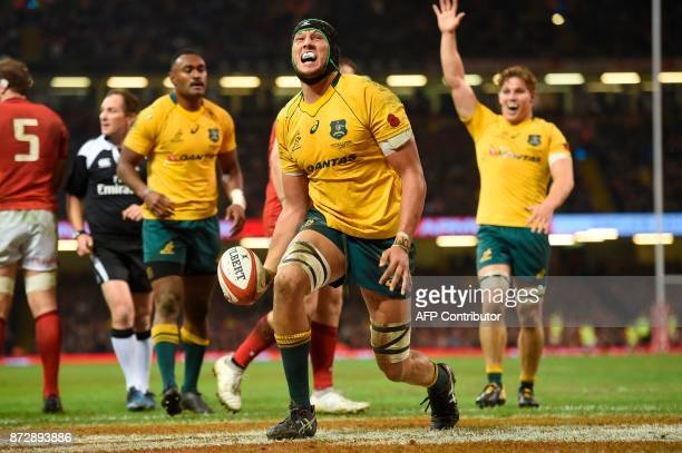 Australia's lock Adam Coleman celebrates scoring a try during the rugby union international Test match between Wales and Australia at the...