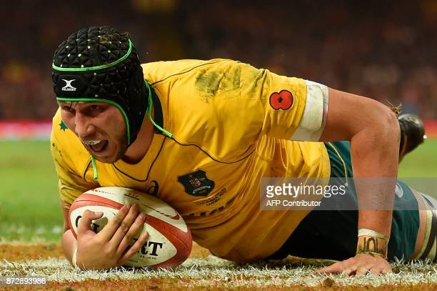 Australia's lock Adam Coleman scores a try during the rugby union international Test match between Wales and Australia at the Principality Stadium in...