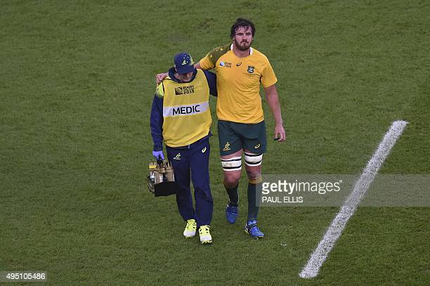 Australia's lock Kane Douglas is brought off during the final match of the 2015 Rugby World Cup between New Zealand and Australia at Twickenham...