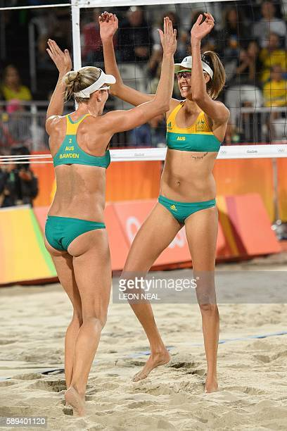 Australia's Louise Bawden and Taliqua Clancy celebrate after beating Poland during the women's beach volleyball round of 16 match at the Beach Volley...