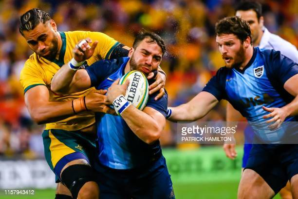 Australia's Lukhan Salakai-Loto tackles Argentina's Facundo Isa the Rugby Championship match between Australia and Argentina at Suncorp Stadium in...