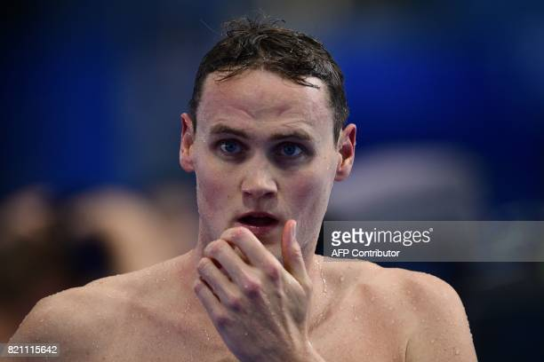 Australia's Mack Horton reacts after competing in a men's 400m freestyle heat during the swimming competition at the 2017 FINA World Championships in...