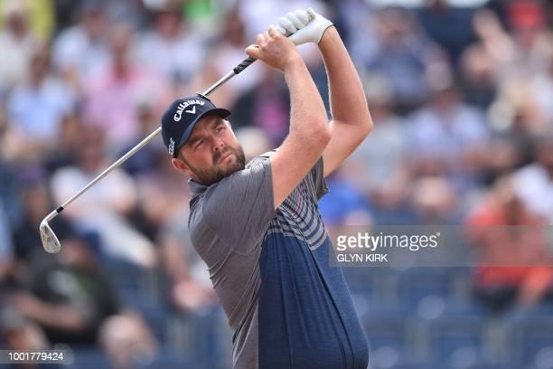 Australia's Marc Leishman watches his iron shot from the 3rd tee during his first round on day one of The 147th Open golf Championship at Carnoustie...